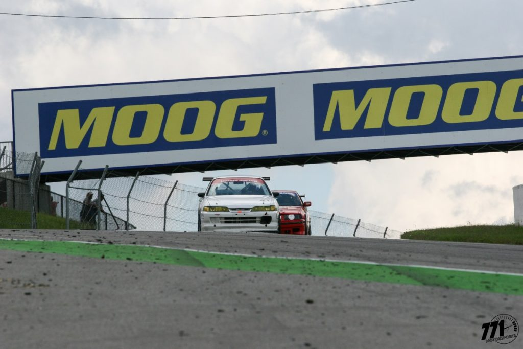 John Dipchand Jr. had a hot start in his Acura Integra Type R, passing Demi Chalkias and her BMW E36 for the lead.